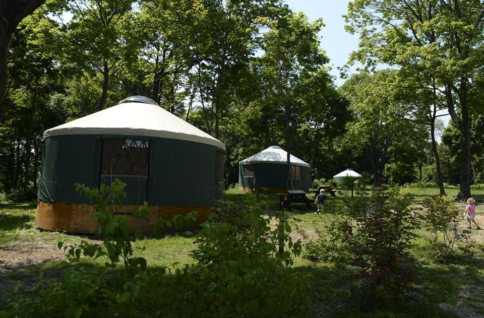 Peddocks Island's yurts have electric lighting, power outlets, beds, and other amenities for overnight visitors to the Boston Harbor site.