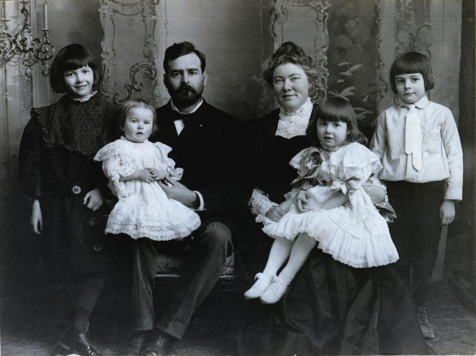 Grace Hall Hemingway documented in a series of scrapbooks her son Ernest Hemingway's life from birth until he turned 18. One of the books included this family portrait from February 1906, with Ernest standing at right.