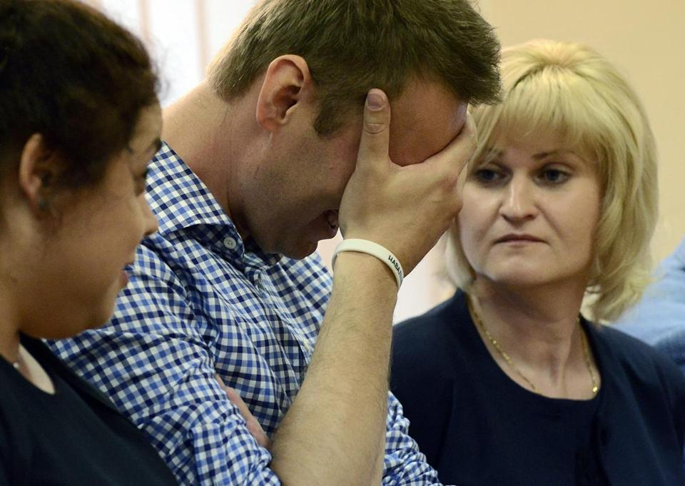 Alexei Navalny reacted as a judge read his sentence.