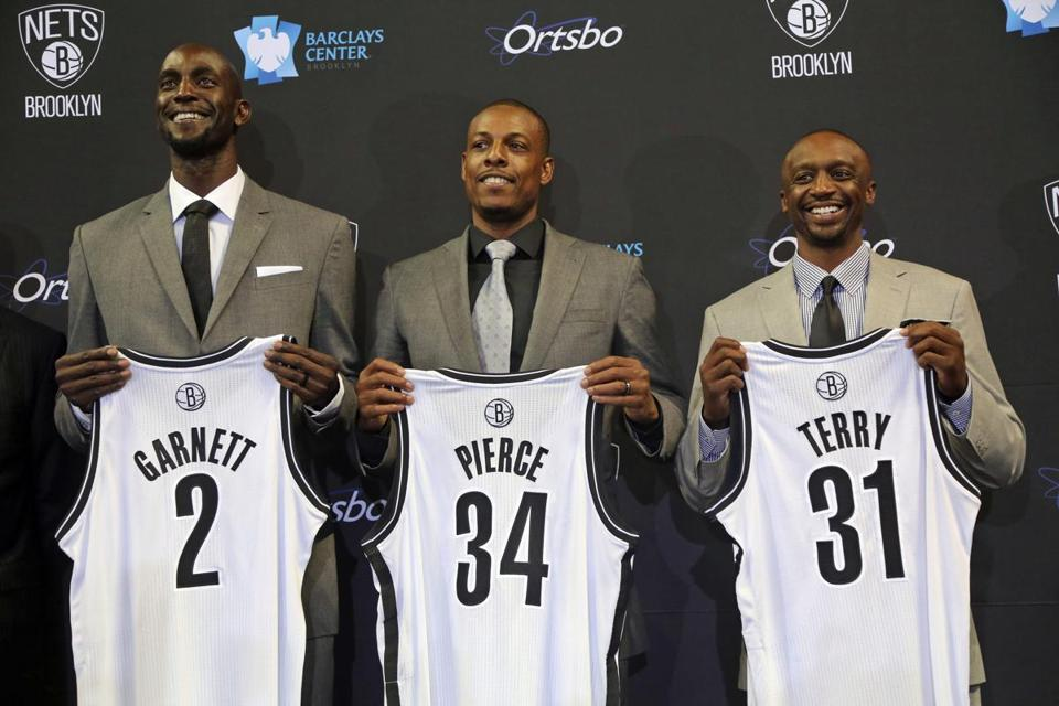 Kevin Garnett, Paul Pierce and Jason Terry showed off their new Nets jerseys on Thursday.