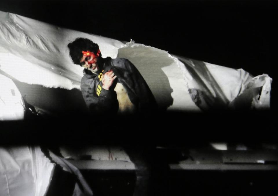 Dzhokhar Tsarnaev, with a red dot from a sniper's laser sight trained on his head, surrended to authorities on April 19.