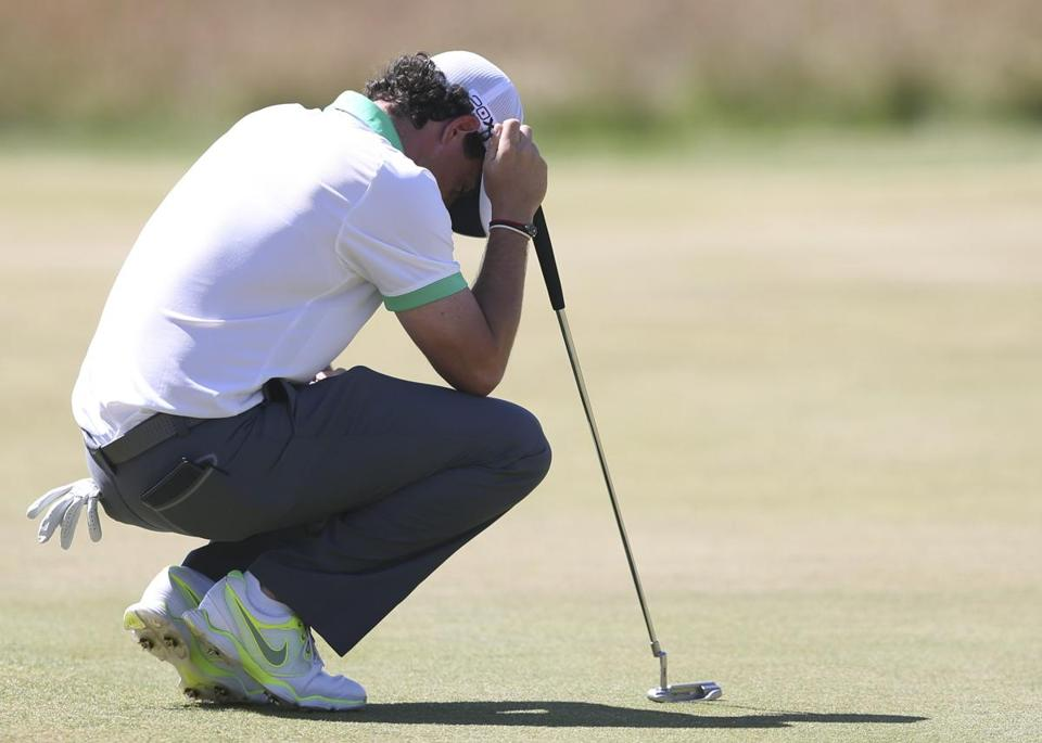Rory McIlroy was almost taken to his knees during an 8-over-par 79 in which he putted off the green into a bunker.