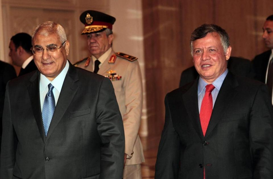 Interim president Adly Mansour (left), who appointed the committee that will propose the amendments, also met with Jordan's King Abdullah (right) in Cairo on Saturday.