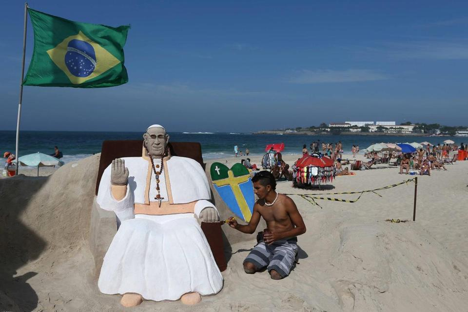 A sculptor crafted a sand likeness of Pope Francis on Copacabana beach in Rio de Janeiro.