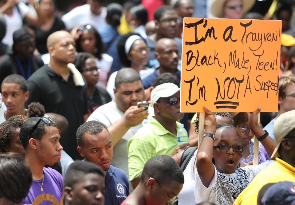 Tyrese Blackwell, 14, displayed his sign at a Houston demonstration for Trayvon Martin.