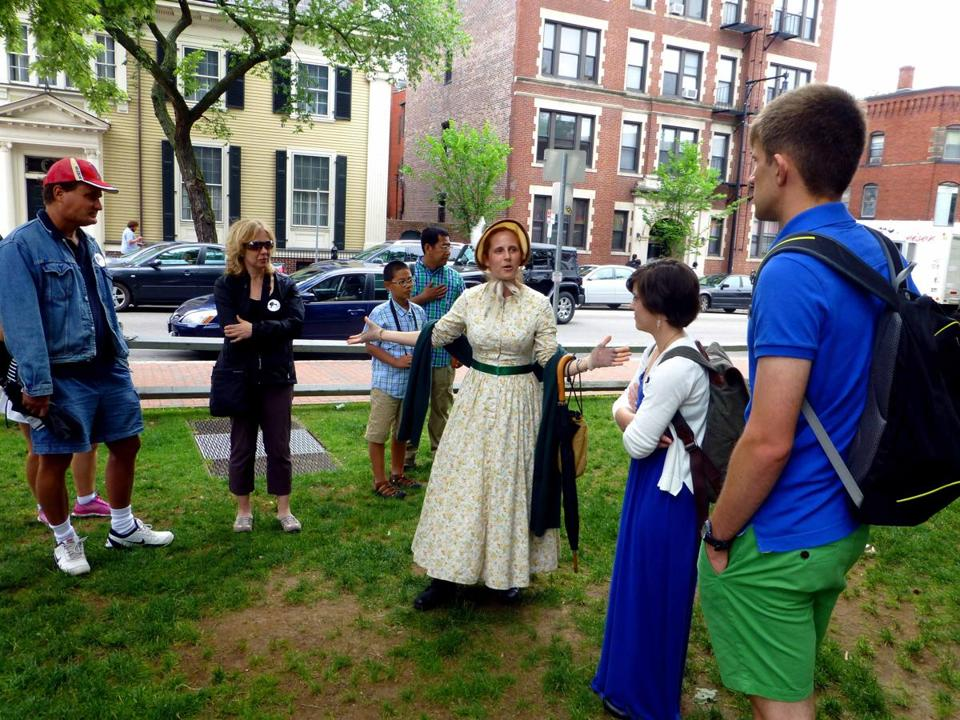 "Caitlin Johnston as ""Alice Longfellow,"" daughter of the 19th-century poet and educator, leads visitors on the Cantabrigia Tour of Old Cambridge."