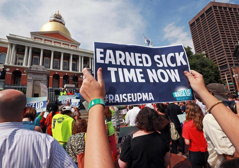 Supporters of proposed ballot initiatives to raise the state's minimum wage and require more employers to allow workers to earn sick days rallied at the State House last July.
