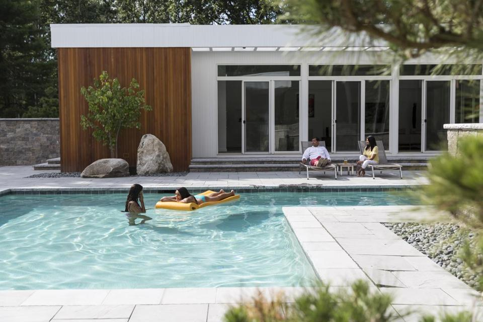A Z-shaped pool, complete with a lap lane and covered hot tub, is the focal point of the Krishnans' backyard.