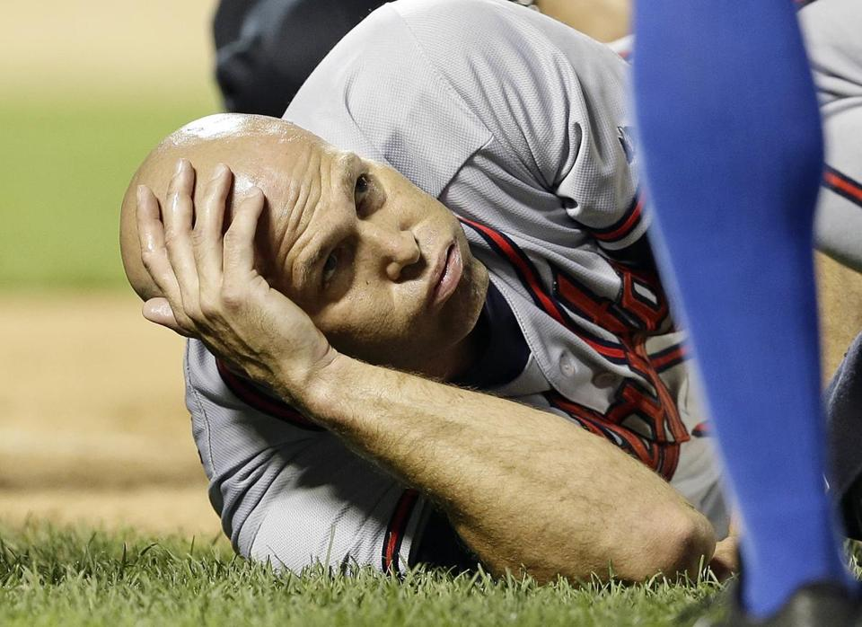 Braves pitcher Tim Hudson suffered a broken ankle when he was spiked while covering first base in the eighth.