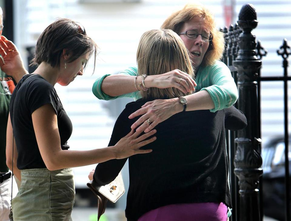Kristyn Dusel (back to camera), a cousin of Amy Lord, received a hug outside a church where a Mass was said for Lord on Saturday.