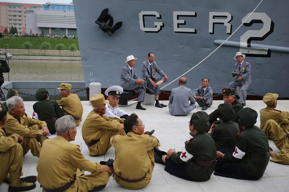 North Korean veterans sat by the Pueblo, a captured US spy ship, after the opening of a museum as part of festivities for the 60th anniversary of the Korean War armistice.