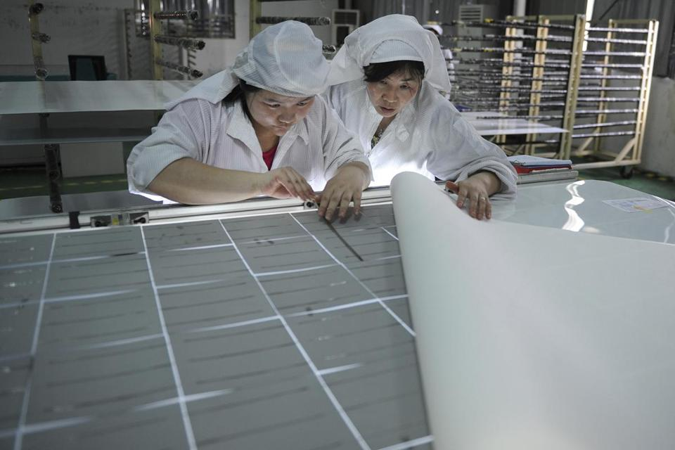 A trade settlement may send more low-cost Chinese solar panels to the United States. Above, a factory in China.