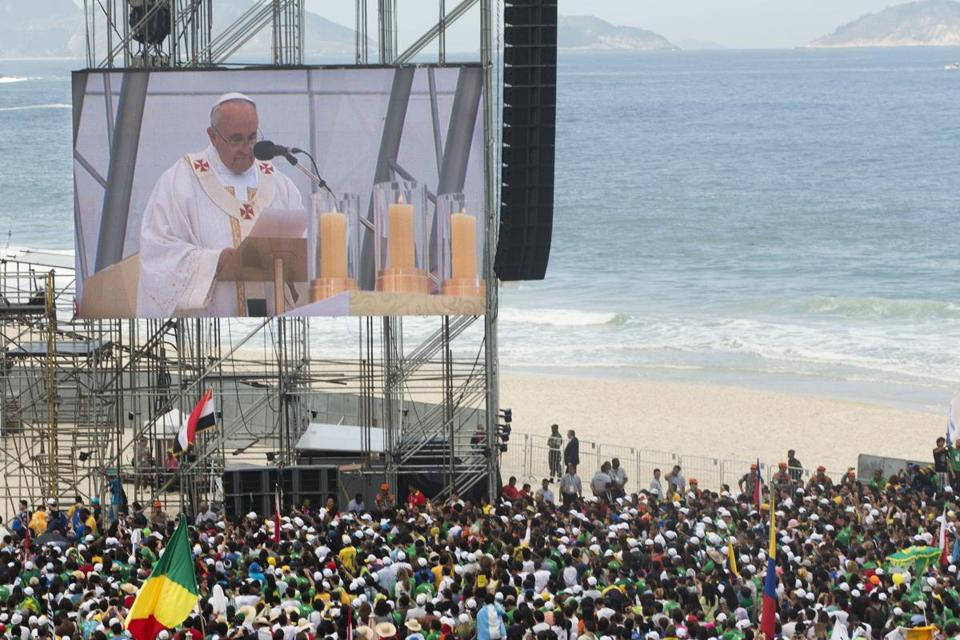 Pope Francis was seen on a large screen as he celebrated the World Youth Day's concluding Mass on Copacabana beach, in Rio de Janeiro, Brazil, on Sunday.