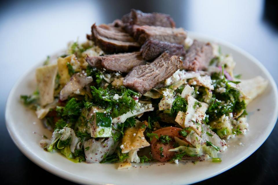 The Salamehs collaborate to run their renovated Cafe Barada. Claude Salameh, the cook, makes fattoush, picutred with lamb; chicken shish kebab; ful mumadamus, and hummus.