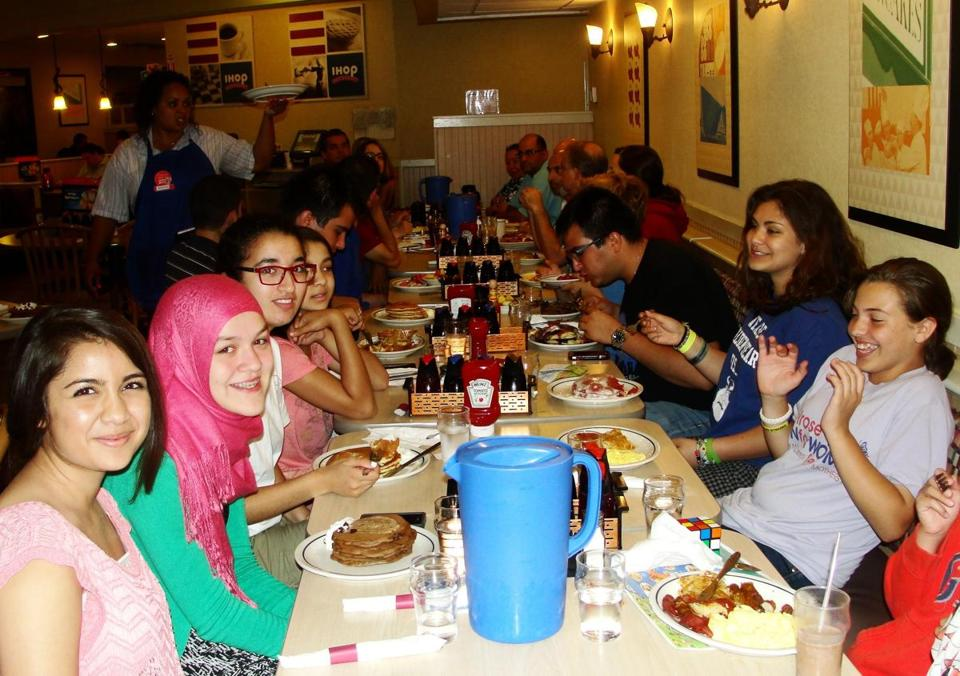 Adults and kids gather early for suhur, a meal before Ramadan fasting, at IHOP. From left: Aliya Moreira, Myriam Ayad, Mariam Ragy, Eamon Khan.