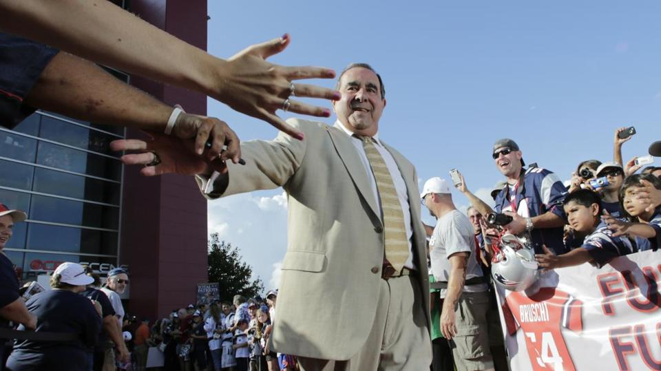 Former New England Patriots broadcaster Gil Santos is congratulated by fans as he walks the red carpet in Foxborough, Mass., Monday, July 29, 2013. Santos and former linebacker Tedy Bruschi were inducted into the Patriots 2013 Hall of Fame. (AP Photo/Charles Krupa)