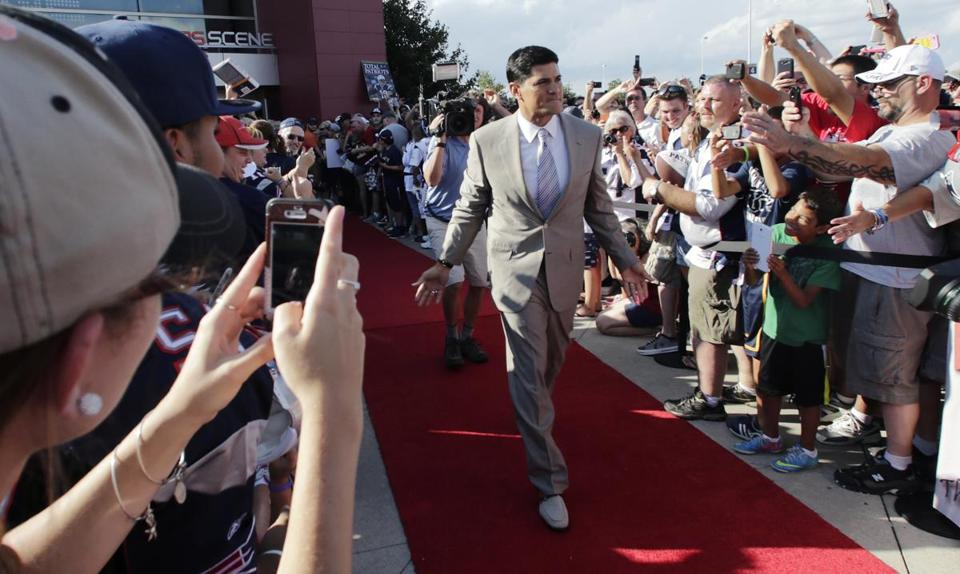 Former Patriots linebacker Tedy Bruschi was congratulated by fans as he walked the red carpet in Foxborough.