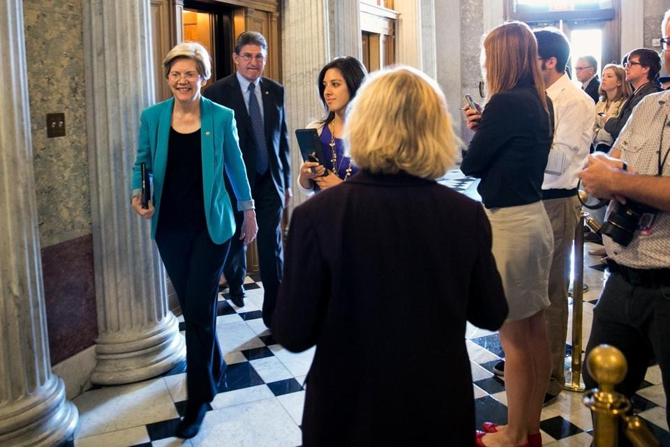 Freshman Senator Elizabeth Warren, on her way to a policy lunch Tuesday, kept walking past reporters rather than engage in an impromptu Q-&-A session — which some see as a Capitol Hill tradition.