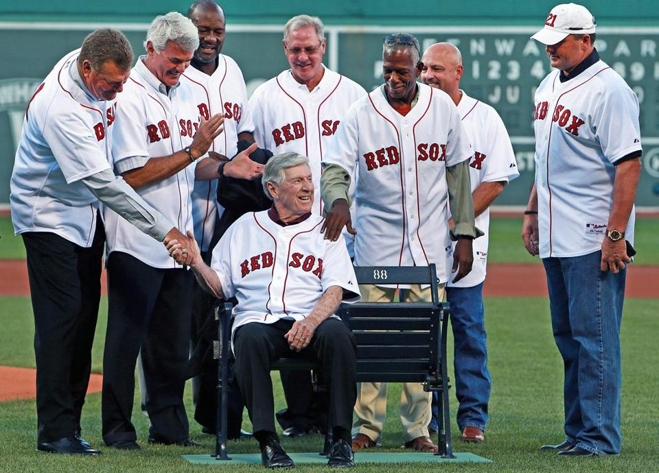 Members of the 1988 Red Sox, including Roger Clemens (right), salute Joe Morgan during a pregame ceremony.