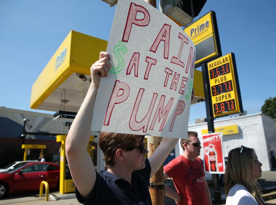 Ted Dooley joined Republican lawmakers and others in protesting the state's new gas tax at a gas station in Dorchester. The new tax went into effect at midnight Wednesday.