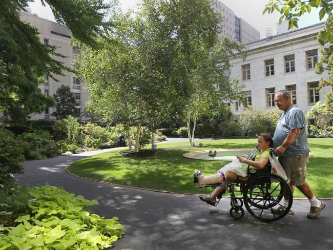 Bobby Campbell of Alabama wheeled his daughter Caroline through the Prouty Garden at Children's Hospital after her foot surgery.