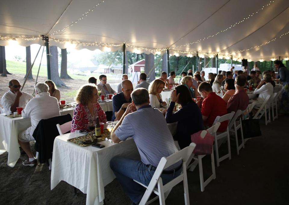 "Diners fill the tent at Smolak Farms in North Andover on a recent summer evening.  These ""Whim Dinners"" are offered for the third year."