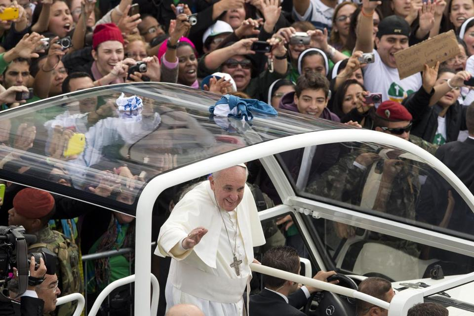 Pope Francis waved from his popemobile on the Copacabana beachfront in Brazil.