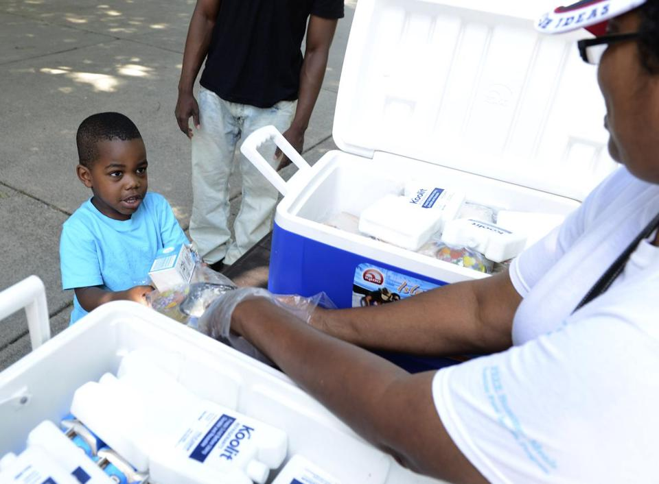 Branden Varilus, 3, of Somerville, was among 243 children who received a free meal outside of the Franklin Park.