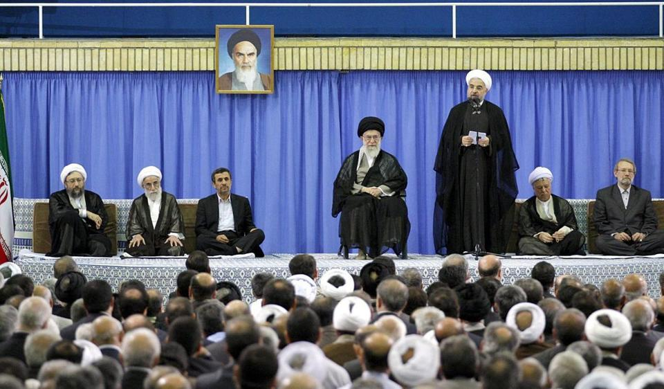 Hasan Rouhani, the new president of Iran, spoke about international sanctions during his installation ceremony in Tehran on Saturday. He received the backing of the country's supreme leader, Ayatollah Ali Khamenei (third from right).