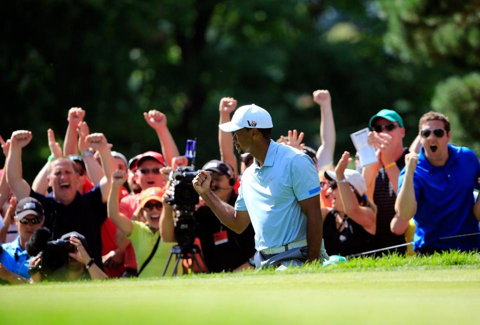 Tiger Woods, who had a more mundane 68 Saturday, chipped in on 13 to excite these fans.