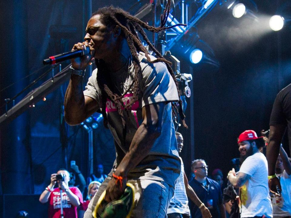 Lil Wayne (pictured performing in New Jersey in June) teamed with T.I. Sunday night at the Comcast Center.