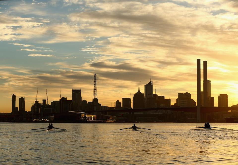 MELBOURNE, AUSTRALIA - MARCH 06: Rowers take to the water for an early morning training session on the Yarra River, March 6, 2013 in Melbourne, Australia. Rowing has been held on the Yarra River for over 150 years. Seven clubs are based in the historic boat sheds on the Alexandra Gardens, they are Banks Rowing Club, Mercantile Rowing Club ,La Trobe University Rowing Club, Melbourne Rowing Club, Melbourne University Boat Club, Yarra Yarra Rowing Club and the Richmond Rowing Club. Rowers from local private schools, elite athletes and members of the public train on the Yarra River on a daily basis from early morning to midmorning then again in the afternoonon. (Photo by Robert Cianflone/Getty Images)