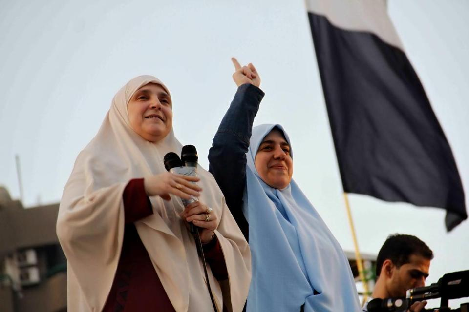 Naglaa Mahmoud (left) said supporters of her husband, Mohammed Morsi, would overcome a military crackdown.