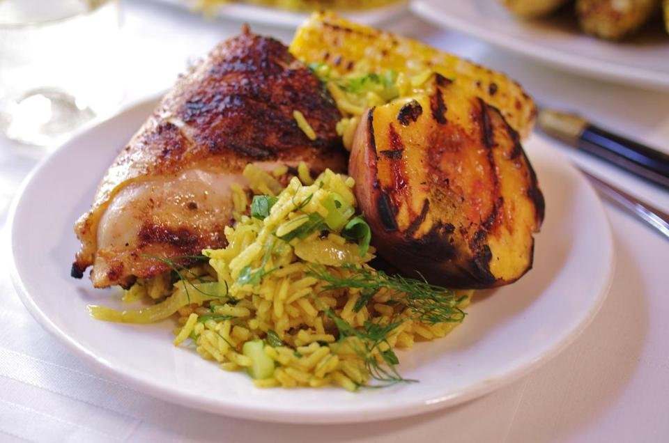 Grilled chicken with peaches and honey-butter corn rice pilaf with cashews and herbs.