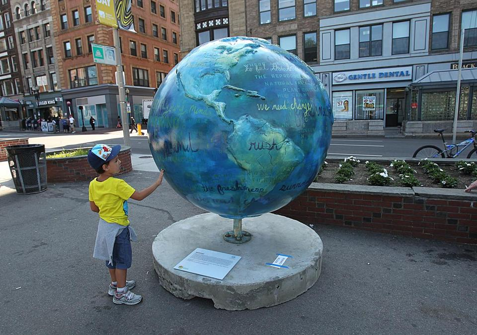Five-year-old Simone Zanetti, of Italy, got a closer look at a globe by Kitauna Parker.