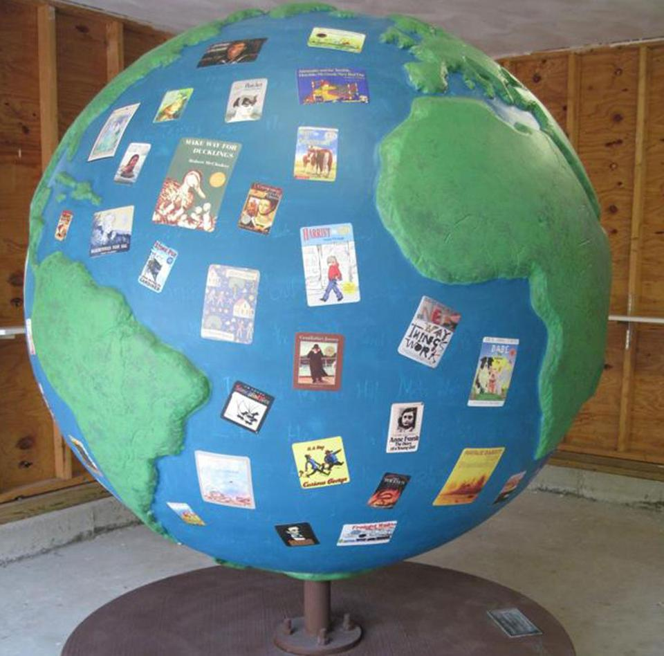 "Nancy Schon's globe is entitled ""Reading Greens The Future."""