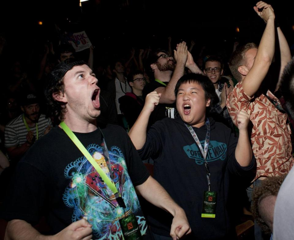 Video gaming fans cheered during a Dota 2 video game competition in Seattle Sunday.