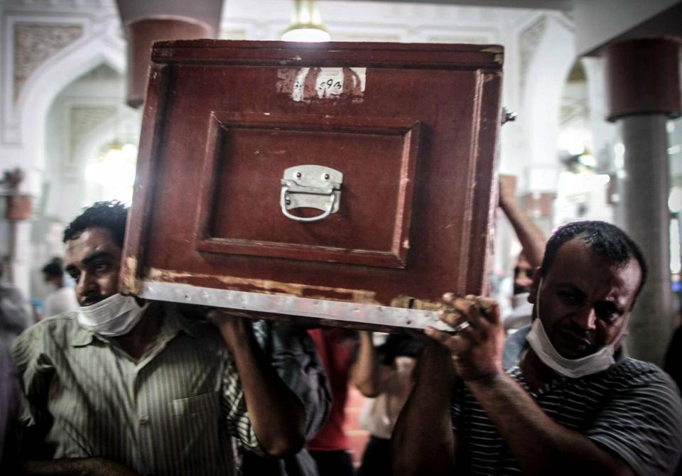 At Al-Imene mosque in Cairo, mourners carried the coffin of a protester slain in Egypt's military crackdown.
