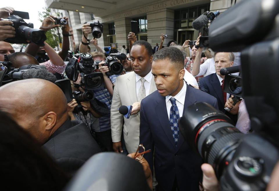 Jesse Jackson Jr., 48, was led from Wednesday's sentencing hearing in Washington. The son of the civil rights leader was once a promising US politician, but he spent campaign funds on expensive personal items.
