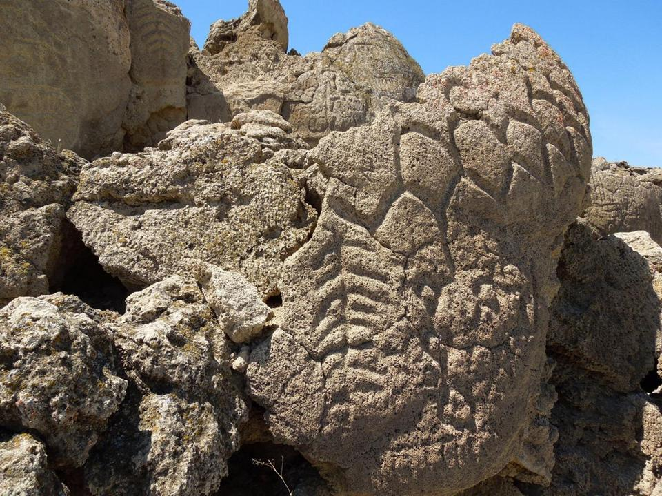 The petroglyphs found on boulders in northern Nevada's high desert are at least 10,000 years old.