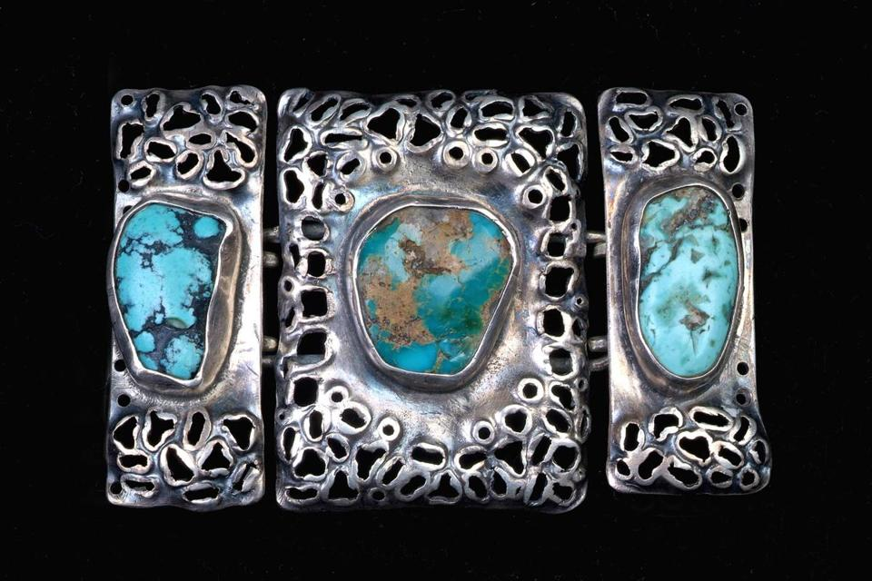A silver and turquoise belt buckle by Madeline Yale Wynne.