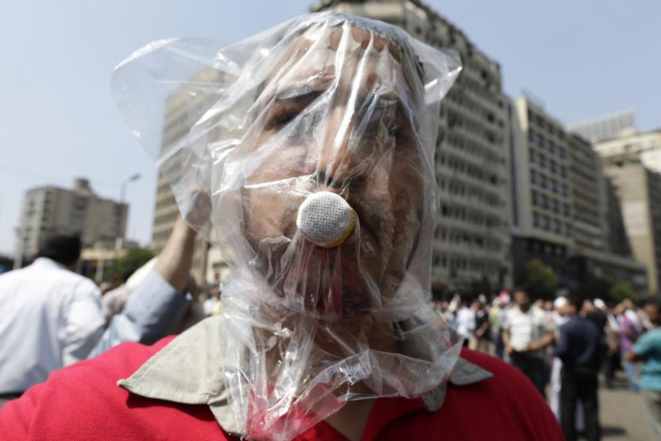 A supporter of Mohammed Morsi wears a homemade gas mask in Cairo Friday.