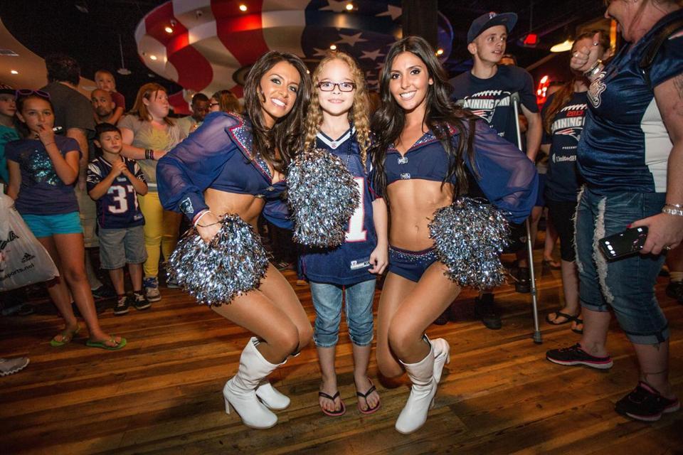 Zoe Bucuvalas and Casey Sullivan (right) posed with Madison Villegas, 8, of Roslindale.
