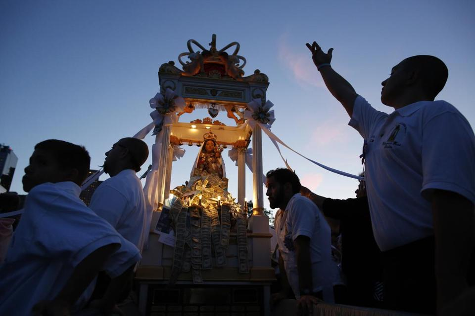 Men carried the statue of the Madonna del Soccorso for a procession around the North End during the Fisherman's Feast.