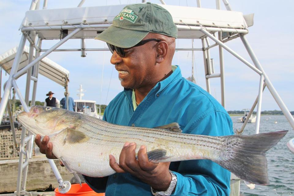 Harvard law professor Charles Ogletree admired a striped bass he caught Thursday.