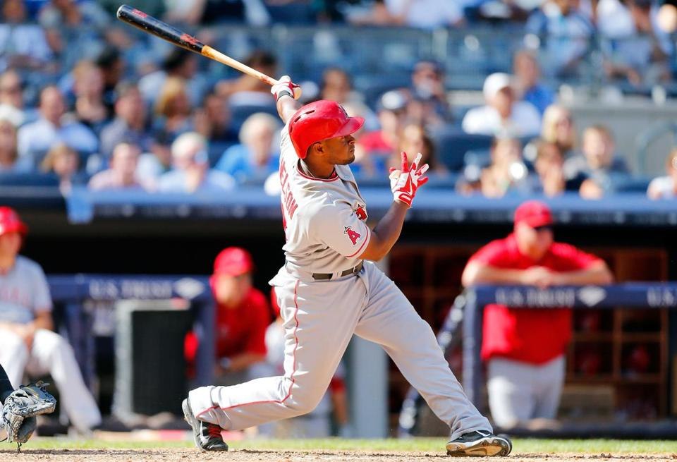 Chris Nelson's eighth-inning grand slam helped the Angels avoid a sweep by New York.