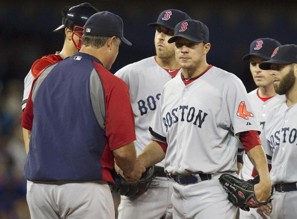 Boston Red Sox manager John Farrell (left) took the ball from starting pitcher Jake Peavy in the seventh inning.