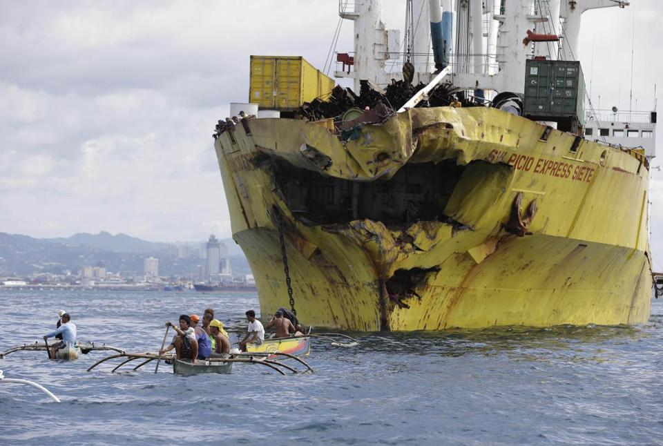 Volunteers searched near the damaged cargo ship Sulpicio Express Siete Saturday, a day after it collided with a passenger ferry near central Philippines.