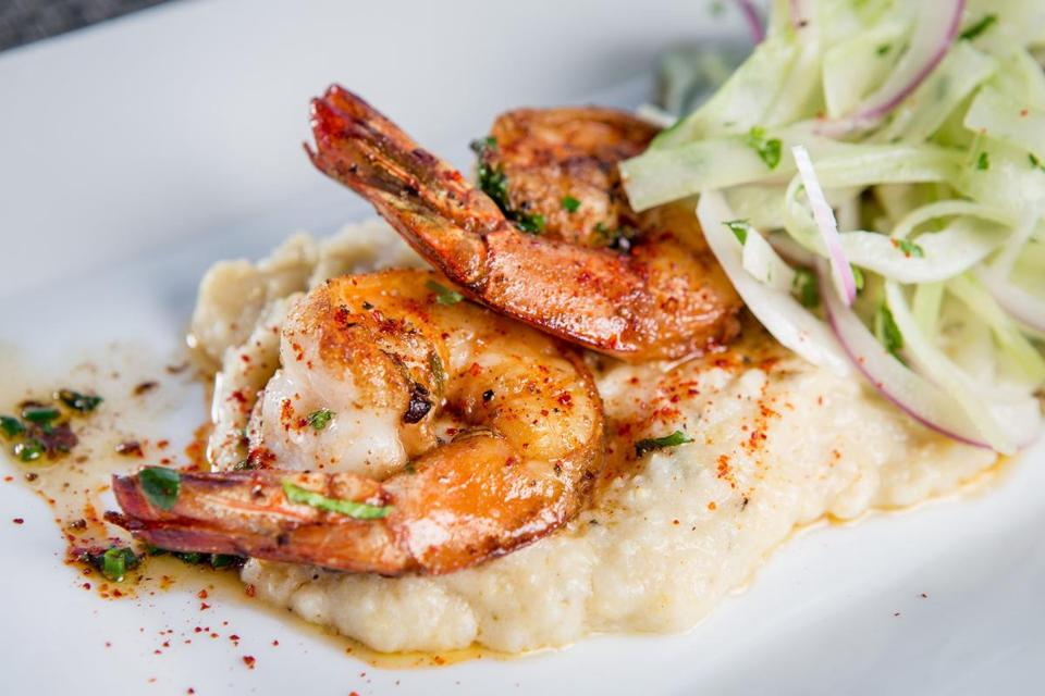 In the shrimp and grits dish at Sam's in Louis Boston, the shrimp are sauteed in whiskey, the grits spicy with jalapeno.