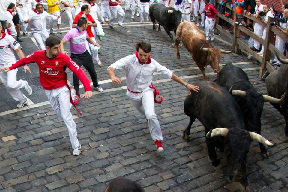 "Pamplona's running of the bulls (generically known as an ""encierro"") is staged each year, July 6-14, as part of the town's cherished San Fermin festival."